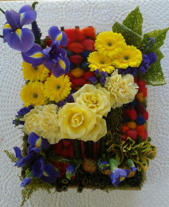 "A  Tapestry arrangement featuring  groupings of 3 or more flowers ""Carpet of Colour""  Exhibit by Mel in March 2014"